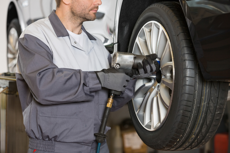 Mechanic repairing vehicle alloy wheel