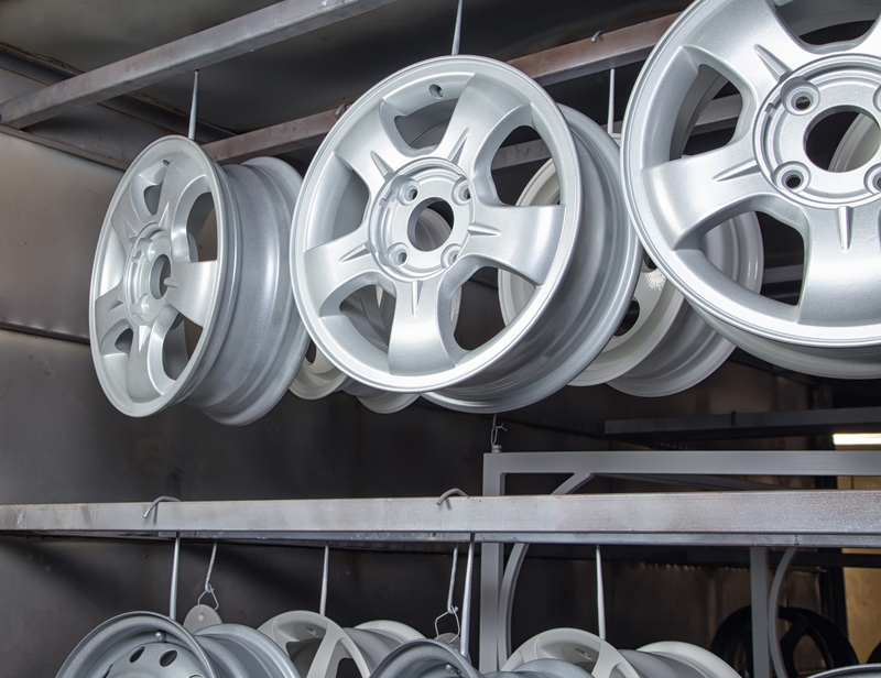 Drying of metal new auto wheels in workshop